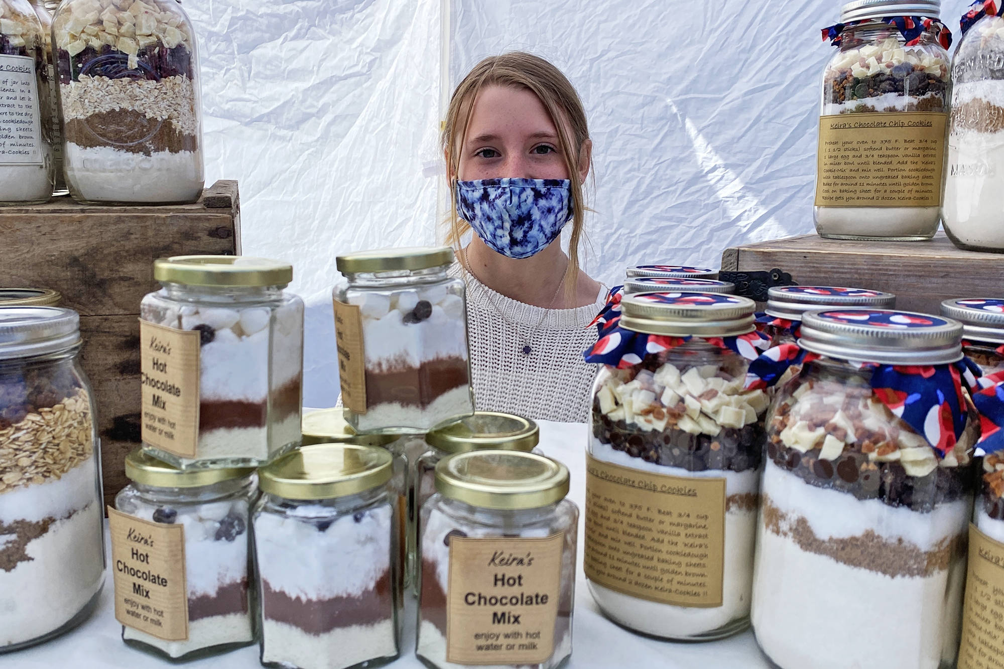 Youth vendor Keira Jaeger displays her very own Keira's Cookies in a Jar, for sale on the opening day of the Downtown Salmon Arm Farmers Market on Saturday, May 8, 2021. (Lachlan Labere-Salmon Arm Observer)